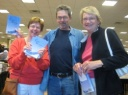 Barb Merritt, Mike Foldes and Maggie Agutter with their signed copies.